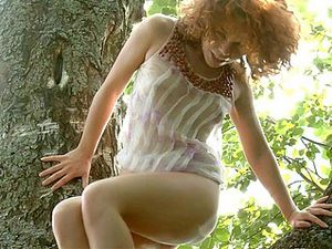 Teen In A Tree Playing With Her Sexy Cunt