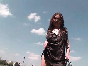Black Satin Dress On A Curly Hair Seductress